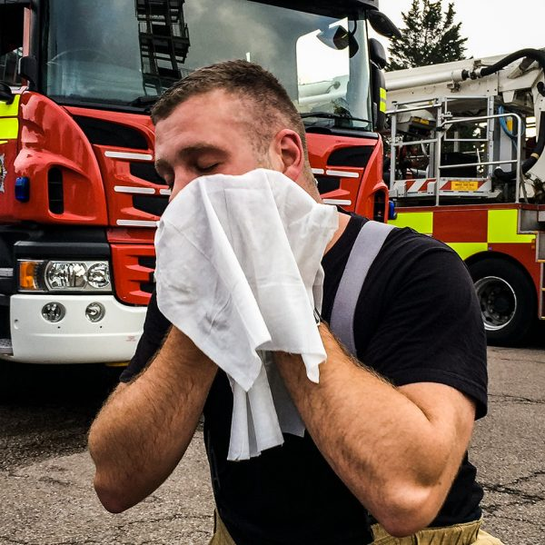 Firefighter Wipes Down Face to Decontaminate After Fire Using De-Wipe