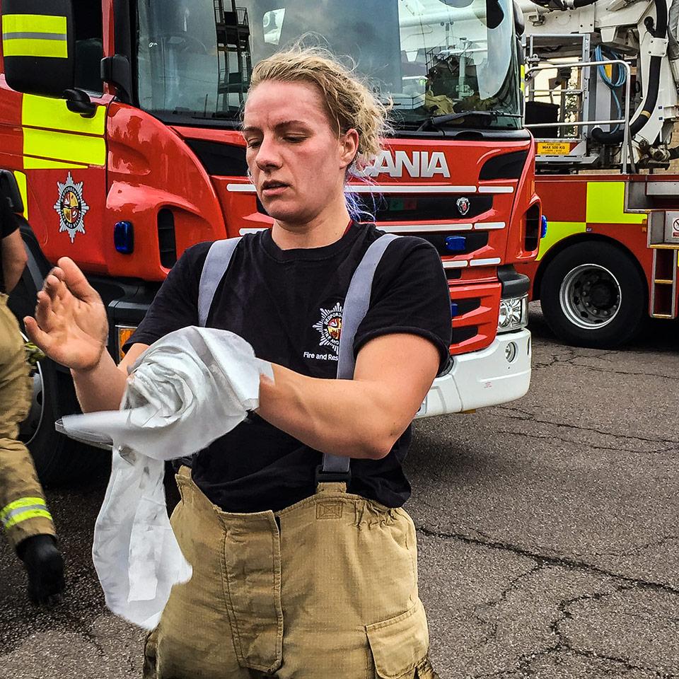 Firefighter Decontaminates Hands with De-Wipe