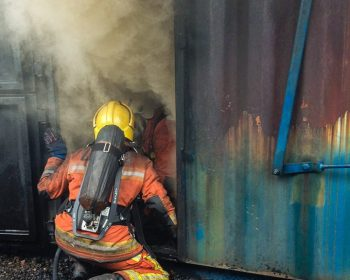 Firefighters Enter Building on Fire Through Smoke-Filled Doorway