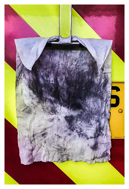 Used De-Wipe After Fire Decontamination Wipe Displayed on the back of a Firefighter Fire Truck