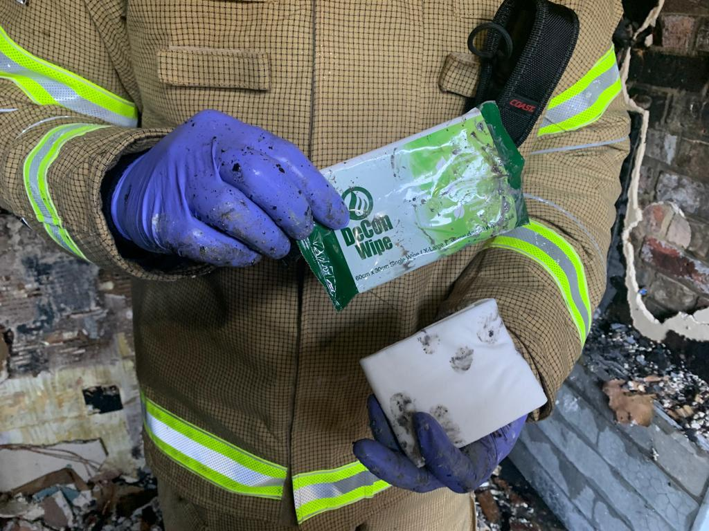 De-Wipe being used by Firefighter to Decontaminate