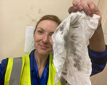 De-Wipe decontamination wipes used to remove carbon black and other carcinogens from skin of worker