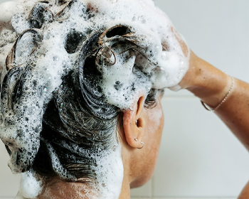 Firefighter in Shower Using After Fire Hair and Body Wash