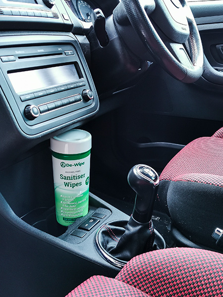 De-Wipe Alcohol Free Sanitiser Wipes displayed in cup holder in car