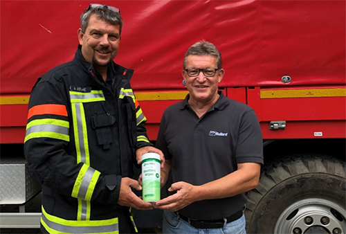 Sanitiser Wipes being donated to a firefighter in Germany